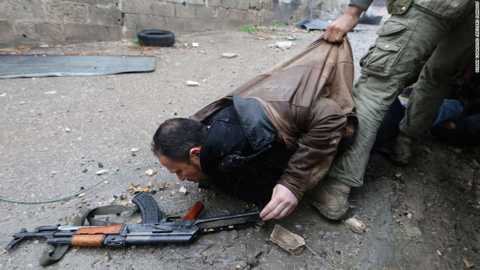 The wounded man is pulled by his jacket.