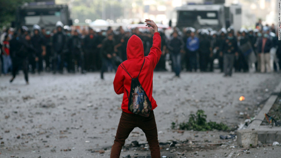 A protester faces off against riot police during clashes near Cairo's Tahrir Square on Wednesday, January 30.