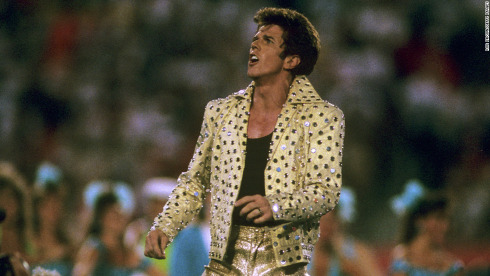 """In 1989, Elvis Presley impersonator Elvis Presto took to the Super Bowl stage in head-to-toe gold lame to <a href=""""http://www.youtube.com/watch?v=b0Mz_TkBvLA&feature=player_embedded"""" target=""""_blank"""">perform</a> """"the world's largest card trick"""" among a bevy of Solid Gold dancers."""