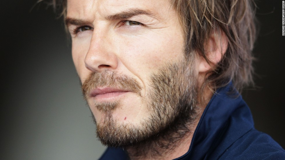 Beckham arrives at Sydney International Airport in 2010.