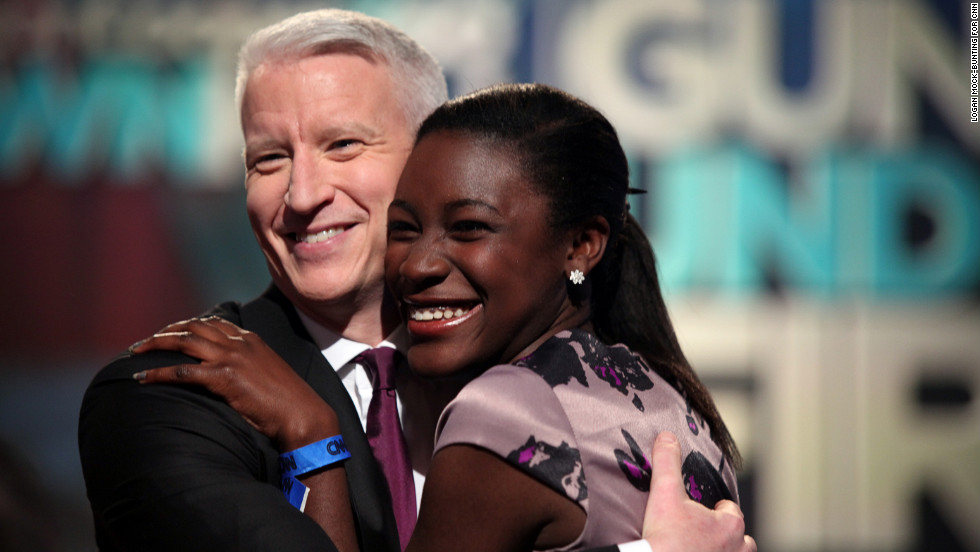 Anderson Cooper embraces a member of the audience at the town hall special.