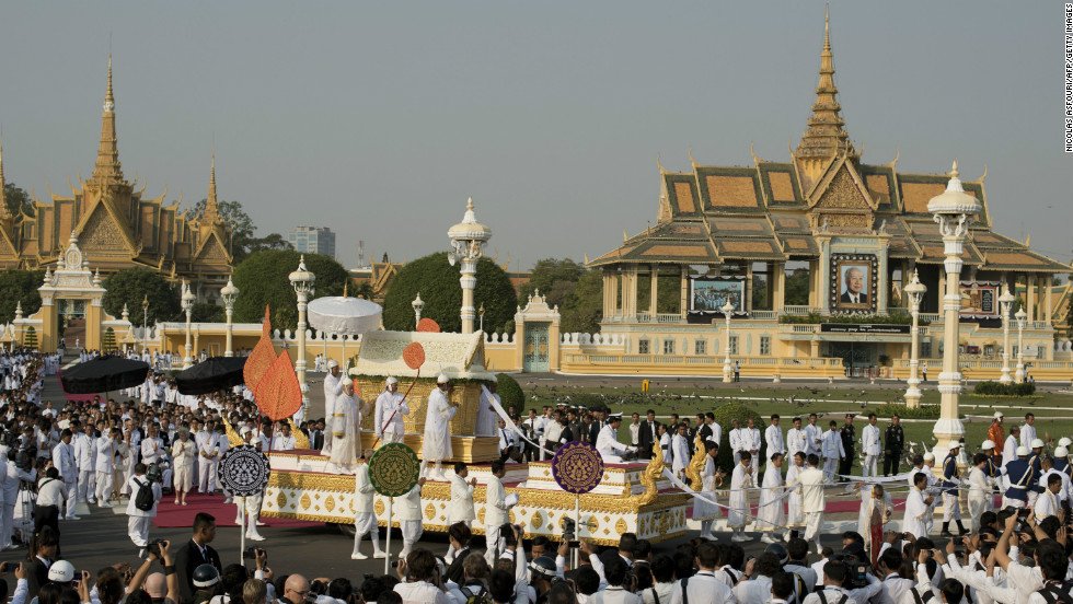 The coffin of the late former King Norodom Sihanouk is seen during his funeral procession in front of the Royal Palace on Friday.