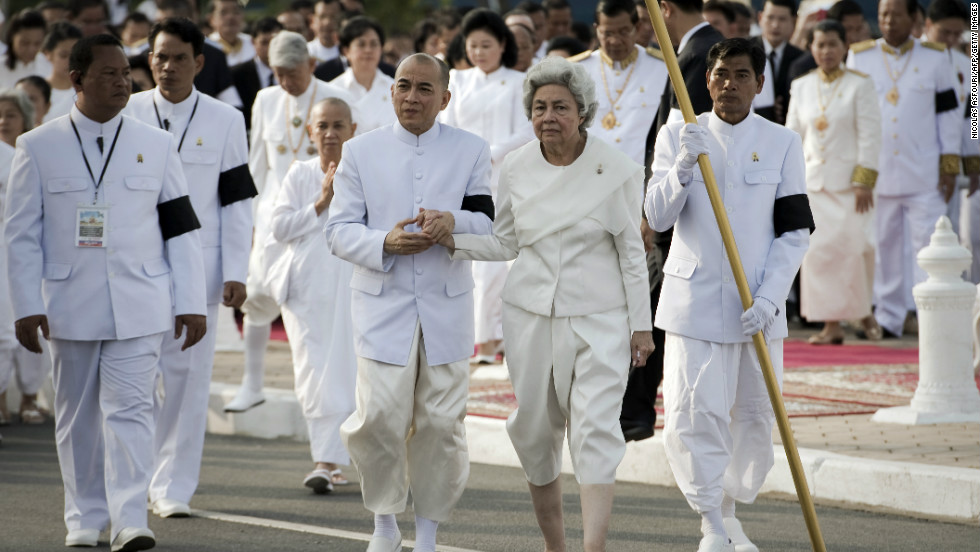 Sihanouk's widow Queen Monique (Center-R) and King Norodom Sihamoni (Center-L) walk through the funeral procession on Friday.