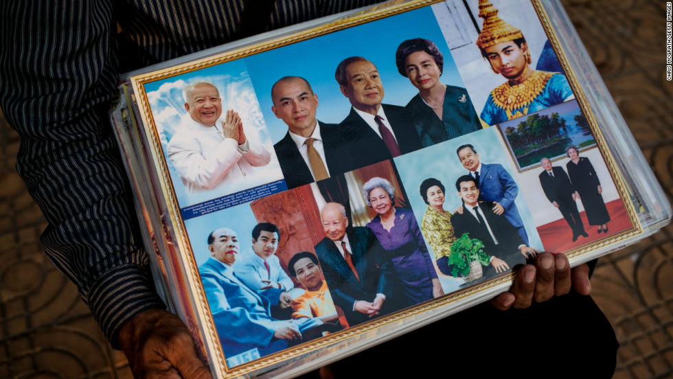 A street vendor sells photographs of former King Norodom Sihanouk outside the Royal Palace on Thursday.