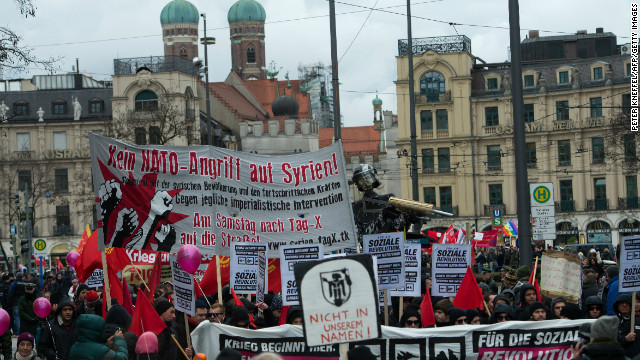 People protest with banners and signs during a rally against the 49th Munich Security Conference on February 2, 2013.