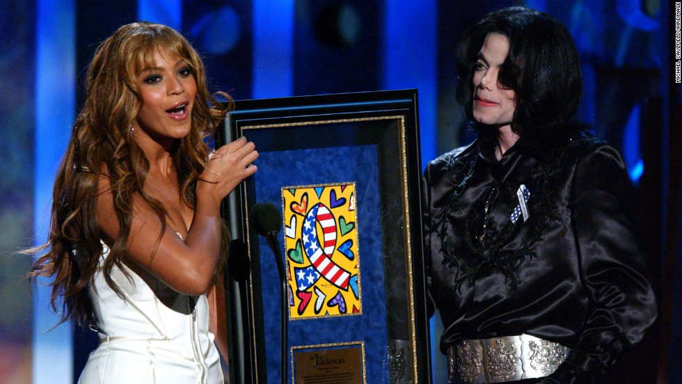 Having stepped out on her own, Beyonce presents the humanitarian award to Michael Jackson at the 2003 Radio Music Awards in Las Vegas on October 27, 2003.