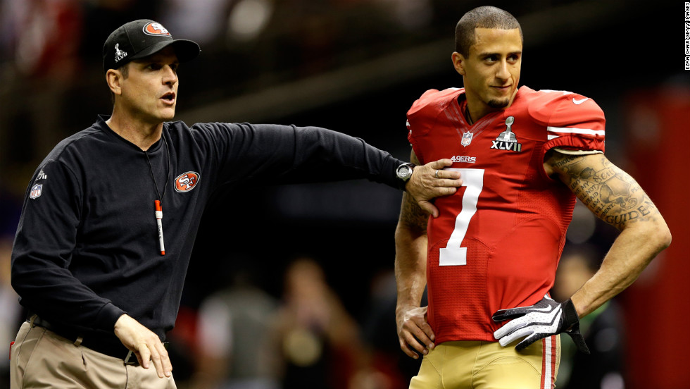 Head coach Jim Harbaugh works with quarterback Colin Kaepernick of the San Francisco 49ers during warm-ups prior to the game.