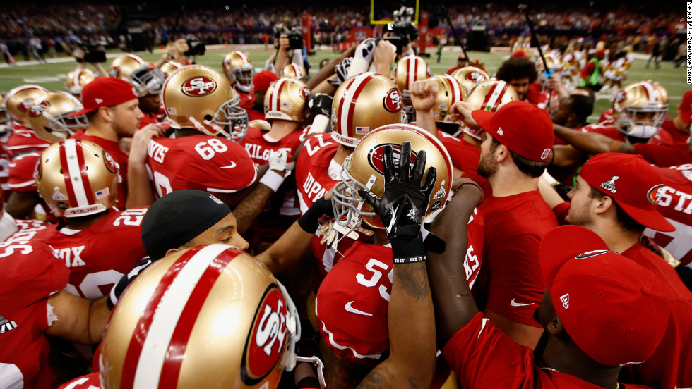 The 49ers huddle up prior to the start of the game.