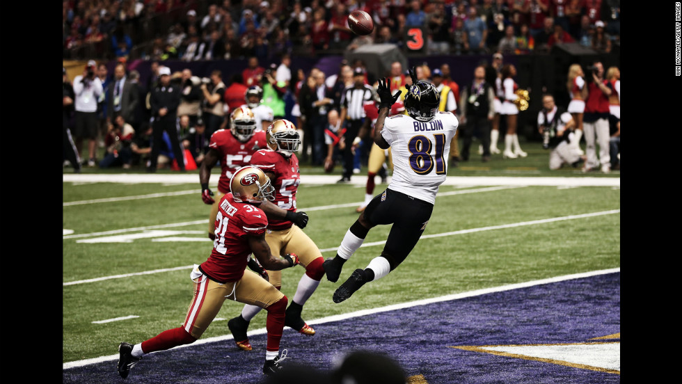 Anquan Boldin of the Baltimore Ravens makes a 13-yard touchdown reception in the first quarter against the San Francisco 49ers during Super Bowl XLVII at the Mercedes-Benz Superdome on Sunday, February 3, in New Orleans, Louisiana.