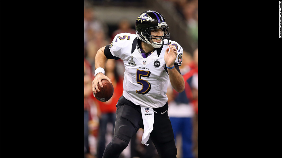 Ravens quarterback Joe Flacco scrambles out of the pocket against the 49ers.
