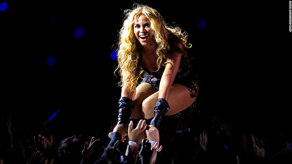 Beyonce greets fans during the halftime show.