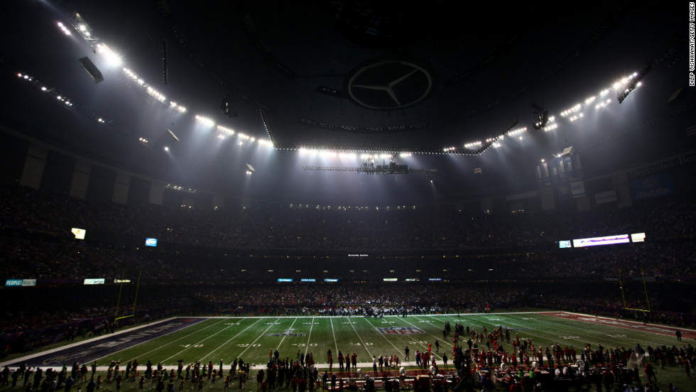 A sudden power outage at the Mercedes-Benz Superdome causes a 34-minute delay early in the third quarter.