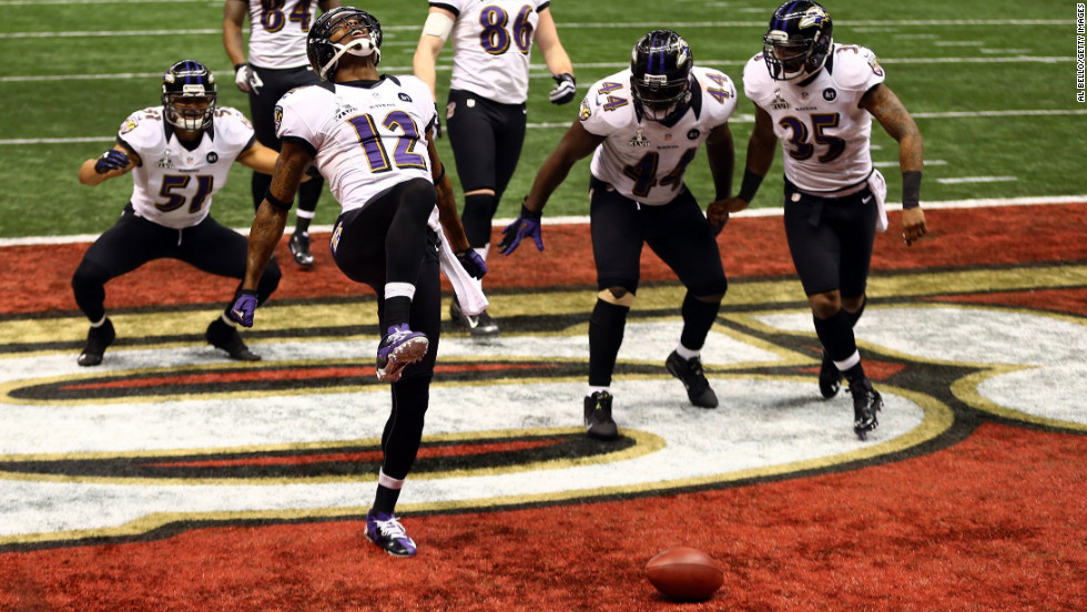 "Jacoby Jones of the Baltimore Ravens, No. 12, does ""the Ray Lewis dance"" to celebrate his 108-yard kickoff return for a touchdown at the start of the third quarter."