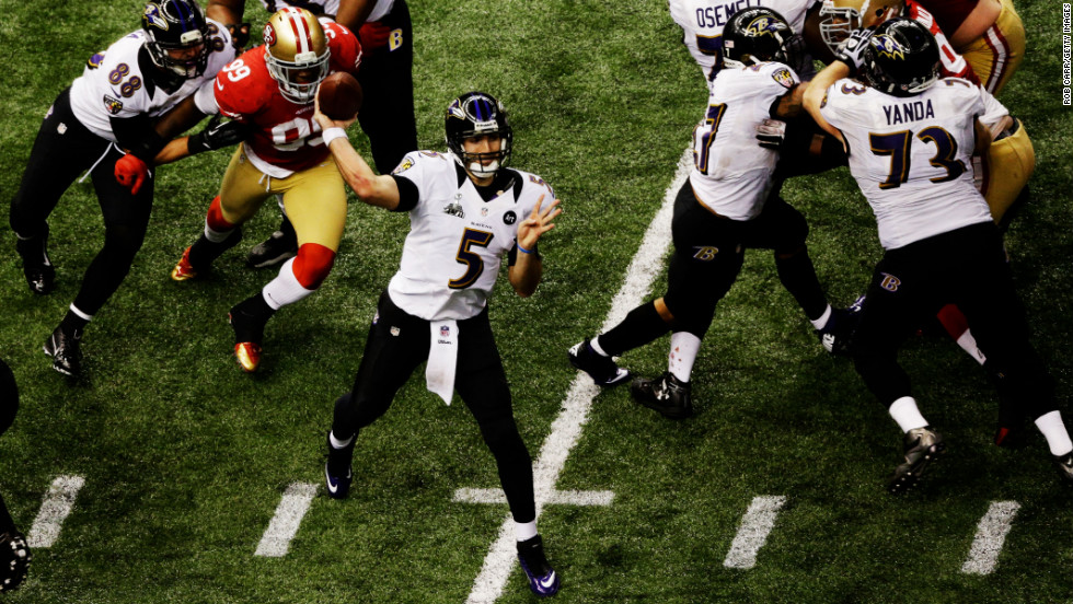 Joe Flacco of the Baltimore Ravens throws a pass in the fourth quarter against the San Francisco 49ers.