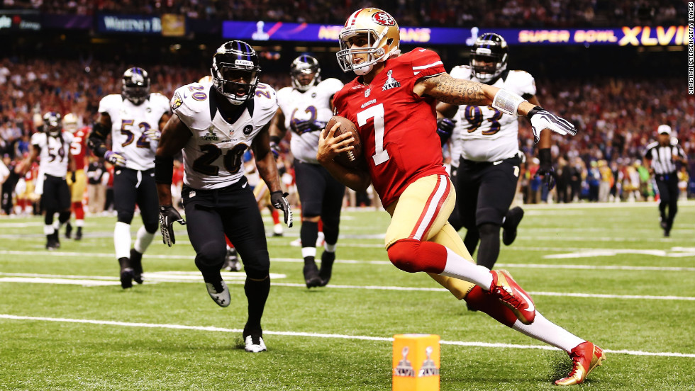 Quarterback Colin Kaepernick of the 49ers scores a 15-yard rushing touchdown in the fourth quarter against the Ravens.