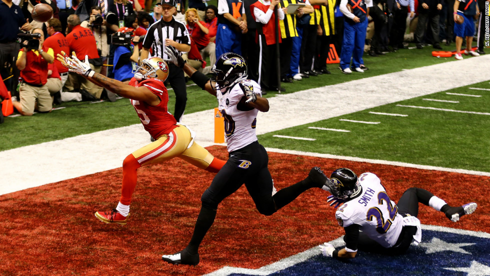 Michael Crabtree of the San Francisco 49ers fails to make a catch in the end zone late in the fourth quarter against Ed Reed of the Baltimore Ravens.