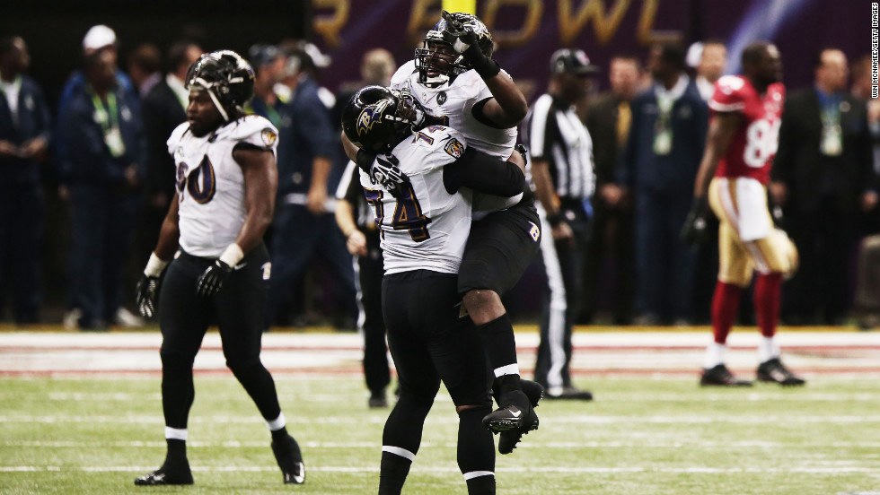 Michael Oher of the Ravens lifts teammate Arthur Jones into the air as the clock runs out.