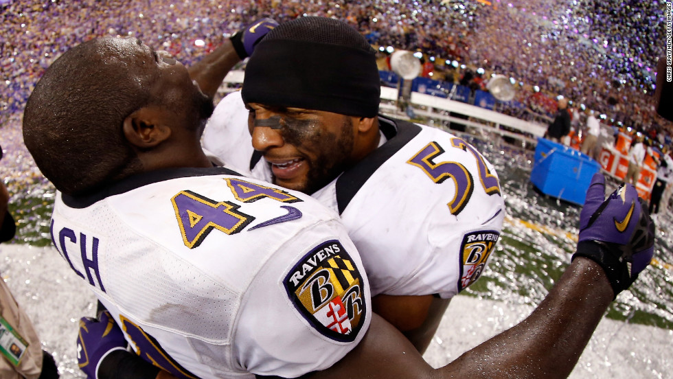 Vonta Leach, left, and Ray Lewis of the Baltimore Ravens celebrate on the field after the game.