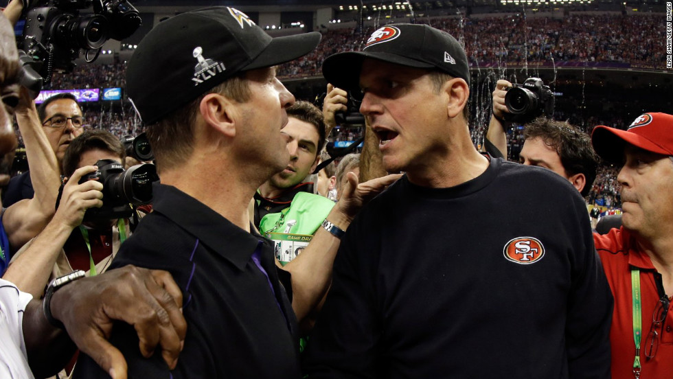Head coach John Harbaugh of the Baltimore Ravens, left, shakes hands with his brother, head coach Jim Harbaugh of the San Francisco 49ers, after winning Super Bowl XLVII in a close contest.