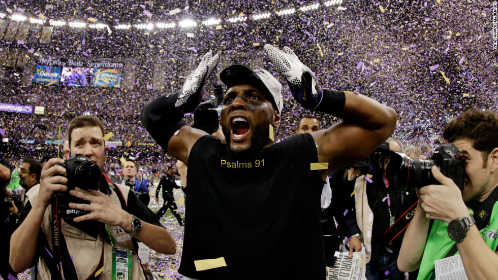 Retiring linebacker Ray Lewis of the Baltimore Ravens celebrates as confetti falls after the game.