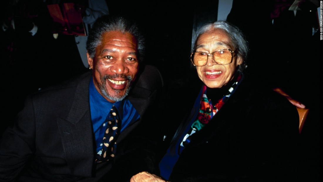 "Morgan Freeman joins Parks at a film premiere party for ""Amistad"" in 1997."