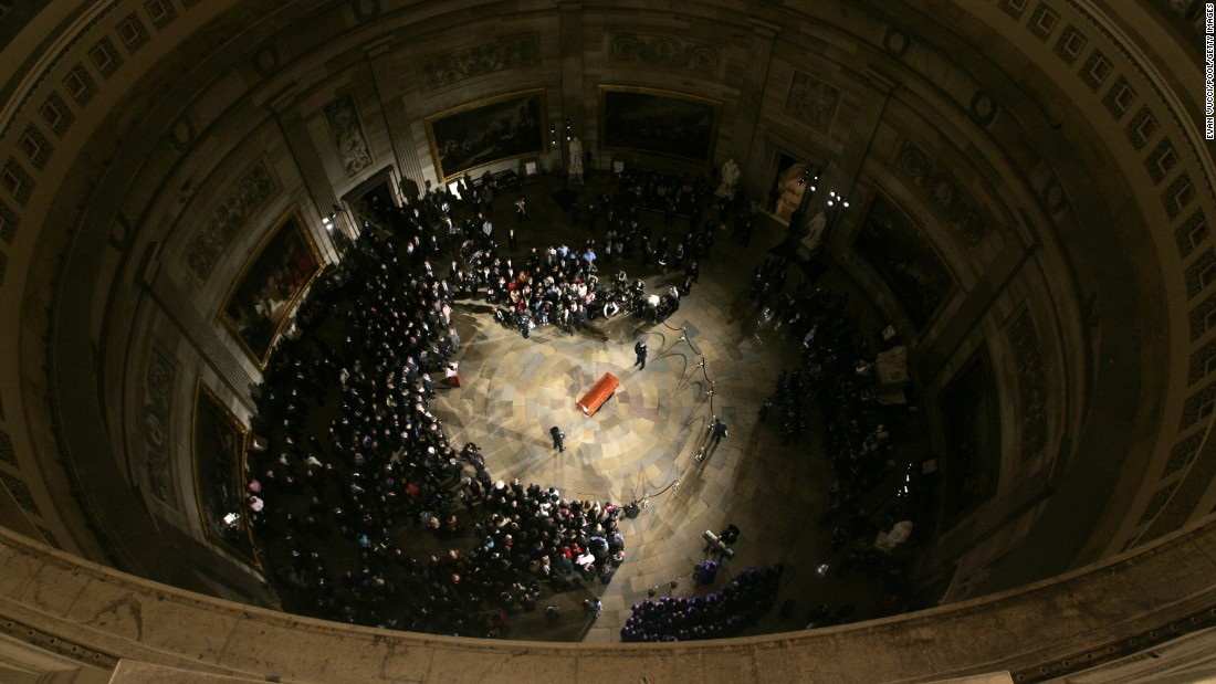 "Parks' casket lies in honor in the U.S. Capitol Rotunda on October 30, 2005, in Washington. The civil rights icon was the first woman and the second African-American <a href=""http://history.house.gov/Institution/Lie-In-State/Lie-In-State/"" target=""_blank"">to lie in honor in the Capitol Rotunda</a>."