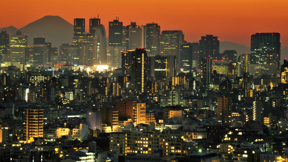 Japan's highest mountain Mount Fuji rises up behind the skyscrapers dotting the skyline of the Shinjuku area of Tokyo, where ultra luxury property sells an average of £5,000 ($7,550) per square foot.