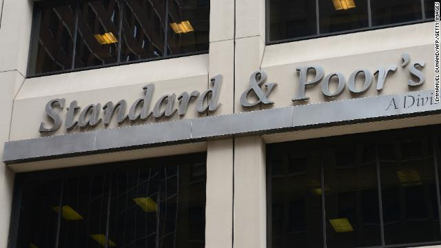 A sign for Standard & Poor's rating agency stands in front of the company headquarters in New York, September 18, 2012.