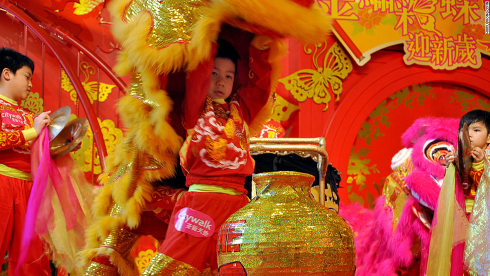 A happy, energized lion is now keen for a drink -- this is the drunken lion dance, after all. On stage a large wine bottle captures the lion's attention. The lion dancers move slowly toward the target, demonstrating a fair bit of suspicion. This imitates a lion's mindful steps upon spotting a target -- biting, smelling and circling the bottle to ensure it isn't a trap.
