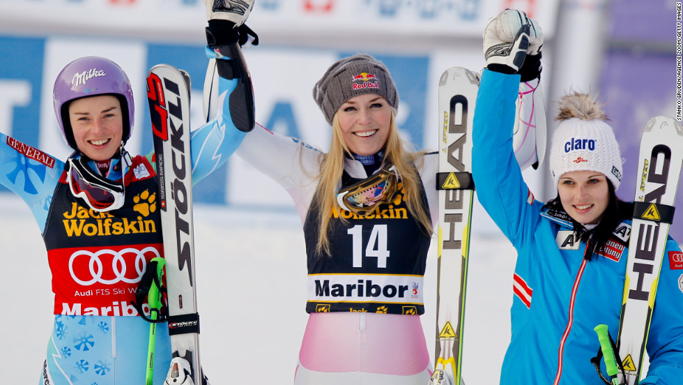 From left, Tina Maze of Slovenia who came in second, Vonn who took first, and Anna Fenninger of Austria who took third celebrate after the Audi FIS Alpine Ski World Cup for women's giant slalom on January 26, 2013, in Maribor, Slovenia.