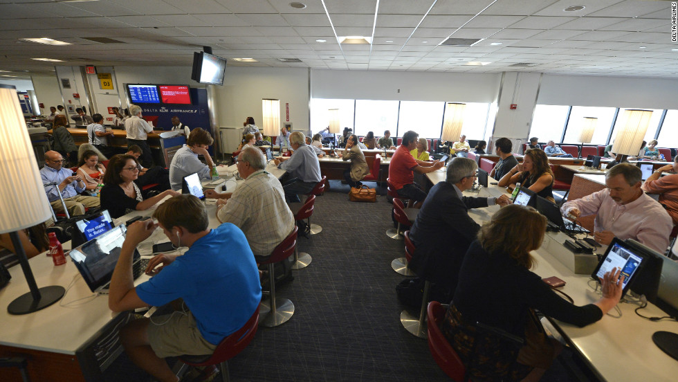 Delta passengers who want to stay at their gate can order food or Duty Free good from mounted iPads.