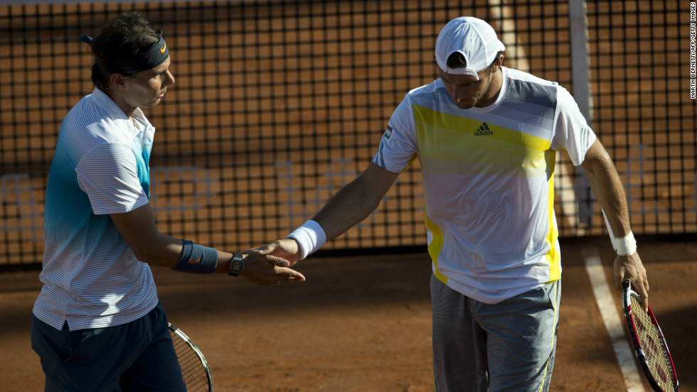 Nadal teamed up with his friend Juan Monaco to win their doubles match against Czech Republic's Frantisek Cermank and Lukas Dlouhy in a Chilean claycourt event.