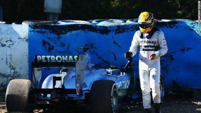 Lewis Hamiton walks away from the wreckage of his new Mercedes following the crash at Jerez, Spain.