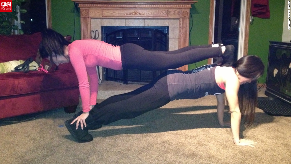 Garcia and her sister Savannah Rae Garcia motivate each other daily, Garcia says. Here they do a double plank together.