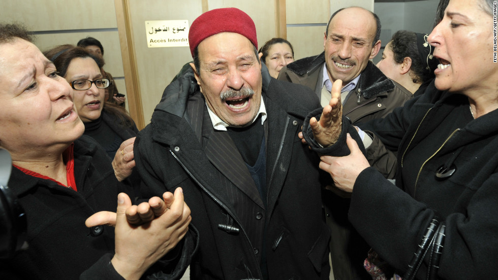 The father of assassinated Tunisian opposition leader and outspoken government critic Chokri Belaid mourns after his killing on February 6, 2013, at a clinic in Tunis.