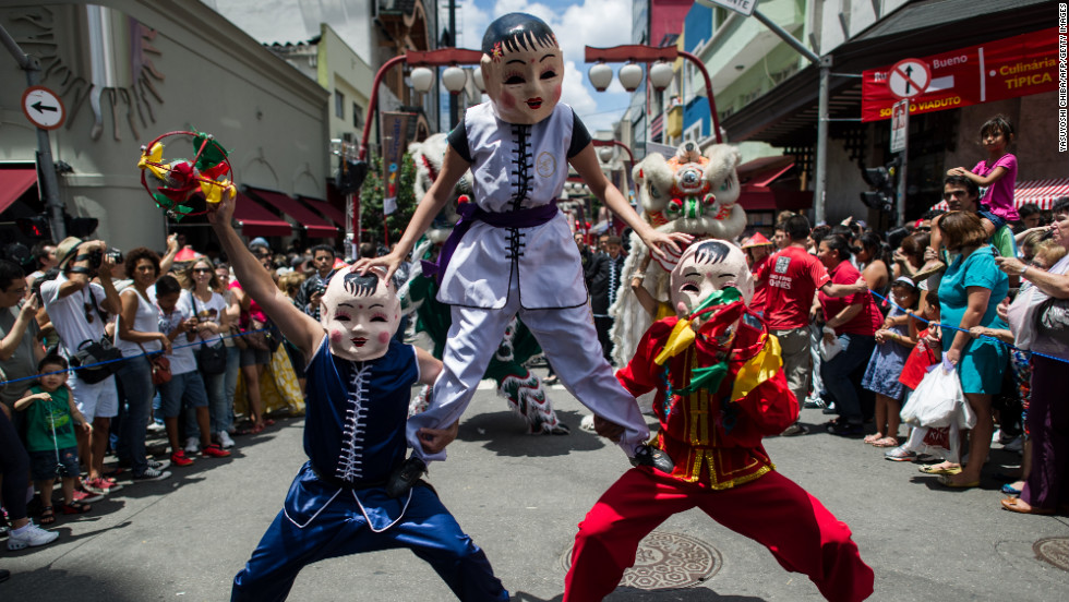Brazilians in costume take part in the Chinese New Year celebrations at Liberdade district in Sao Paulo on Saturday, February 2.
