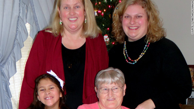 Tabitha McMahon, top right, poses for a holiday photo with her daughter, mother and grandmother.