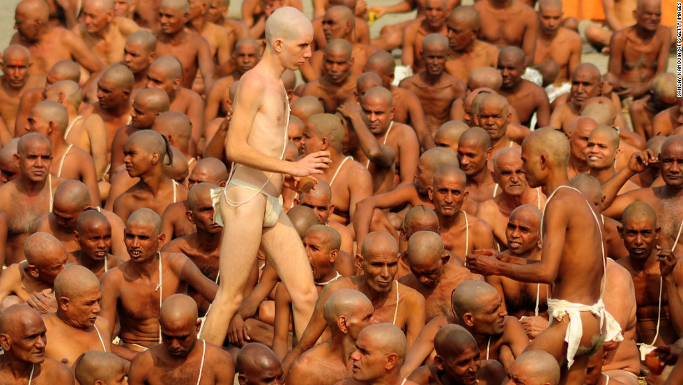 Naga Sadhus perform rituals on the bank of the Ganges River on January 30.