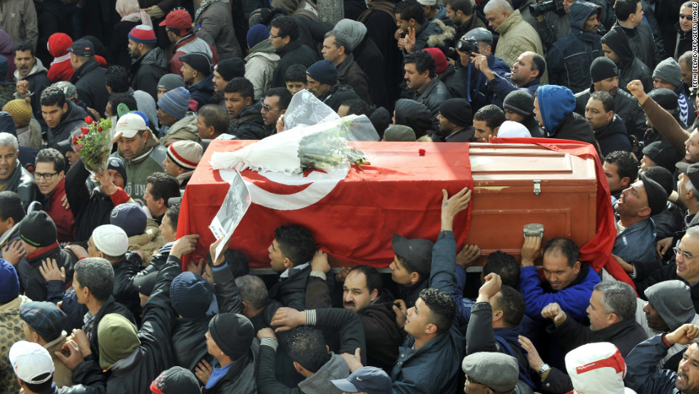 People carry the coffin of late opposition leader Chokri Belaid on February 8, 2013.