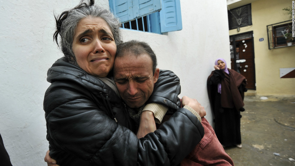 Unidentified friends and relatives of assassinated Tunisian opposition leader Chokri Belaid mourn.