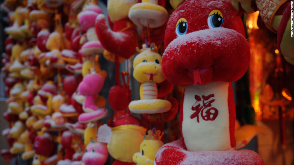 Snow covers toy snakes displayed at a Shanghai market February 8.