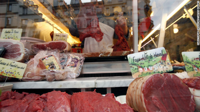 A butcher prepares meat at his horse-meat shop in Paris in January 2007.