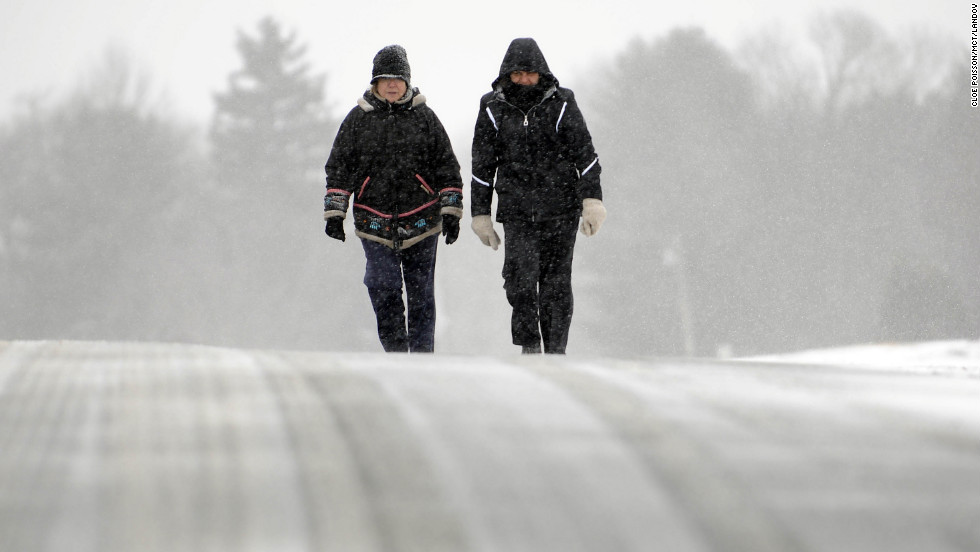 Ines Cuadrado, left, and Anne Levine trek along a snow-covered road in Middlefield, Connecticut, on February 8.