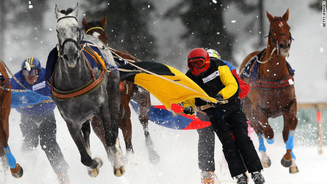 Competitors take part in the Skikjoring Trophy race during the White Turf horse racing meeting held on the frozen Lake St Moritz on February 19, 2012 in St Moritz, Switzerland.