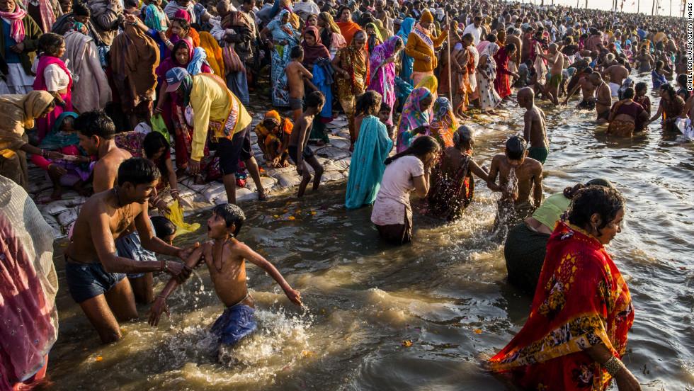 Hindu devotees bathe on the banks of the Sangam on February 9.