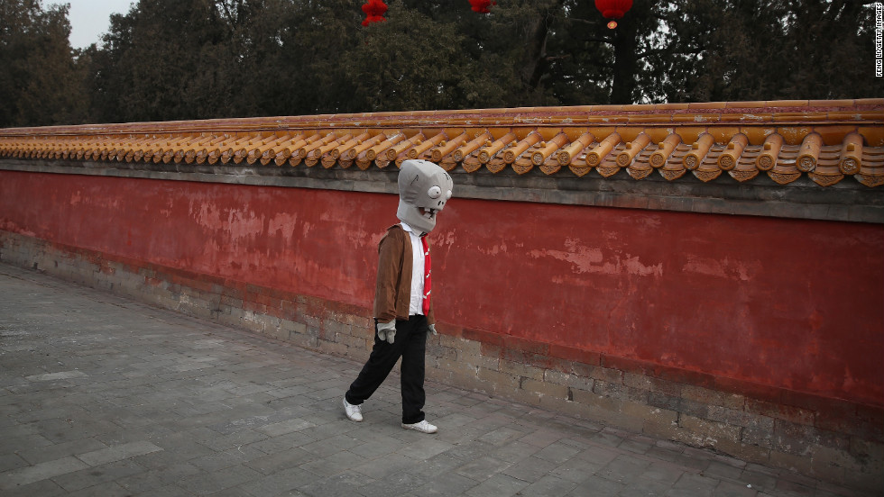 A Chinese actor wearing a mask walks around Ditan Park on February 9.