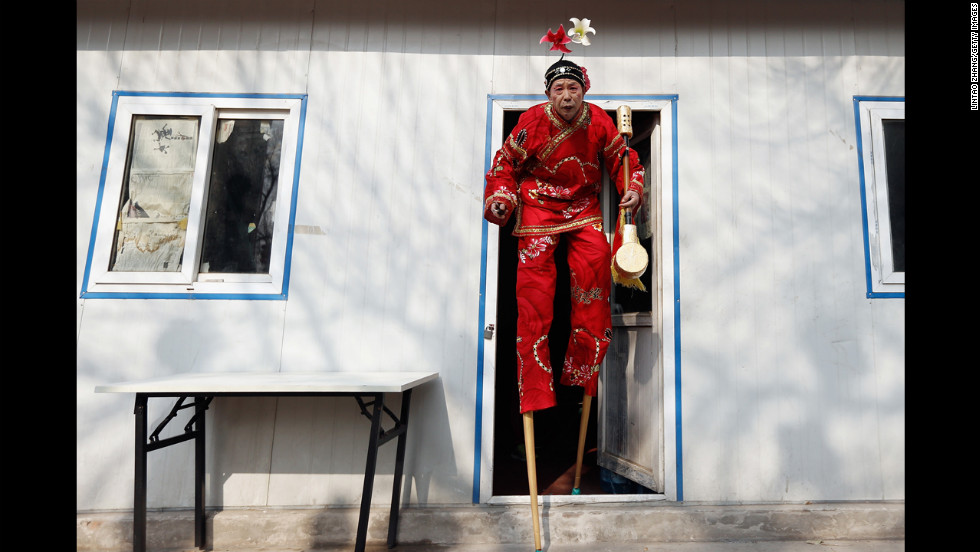 A man prepares to perform during a ceremony celebrating the Chinese New Year in Beijing on February 9.