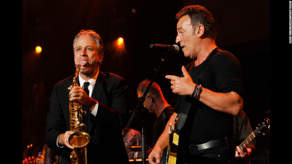 Host John Stewart and Springsteen goof around onstage.
