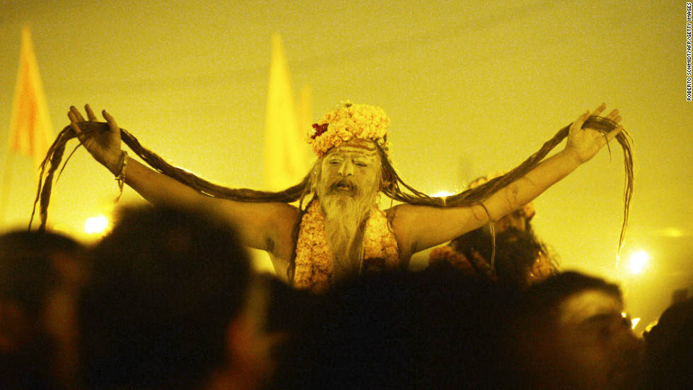 A naga sadhu, or holy man, shows off his 'jata' (long hair) as he marches to the Sangam on February 10. Naked saints covered with ash led the ritual bathing before dawn.