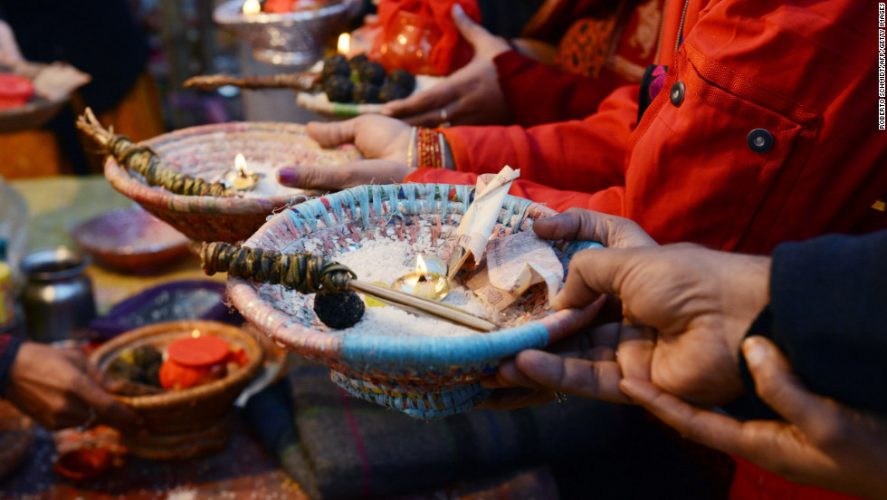 Hindu devotees hold offerings during a blessing ceremony on the banks of the Sangam on February 10.